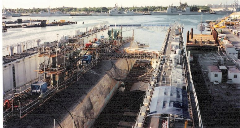 Submarine in a floating drydock at S19 & S20 of Submarine Base Pearl Harbor.