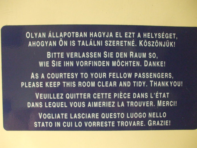 Multi-language sign in the washroom on board EuroCity passenger train from Budapest to Prague.