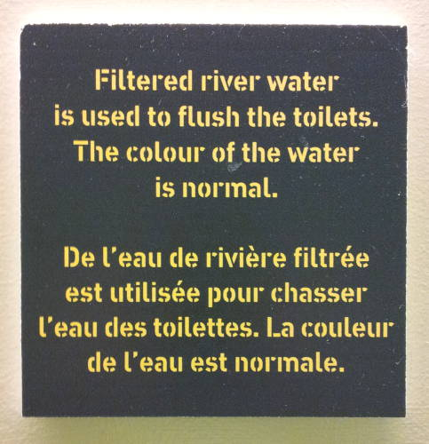 Sign about unfiltered river water used to flush toilets, in the War Museum in Ottawa.
