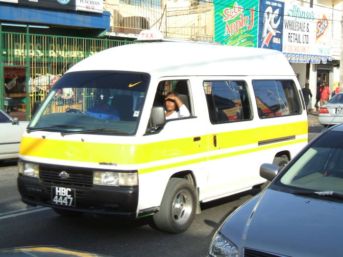 Maxi-taxi shared van moves through Port of Spain, Trinidad.
