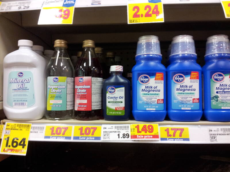 Bottles of laxatives: mineral oil, castor oil, and magnesium citrate.