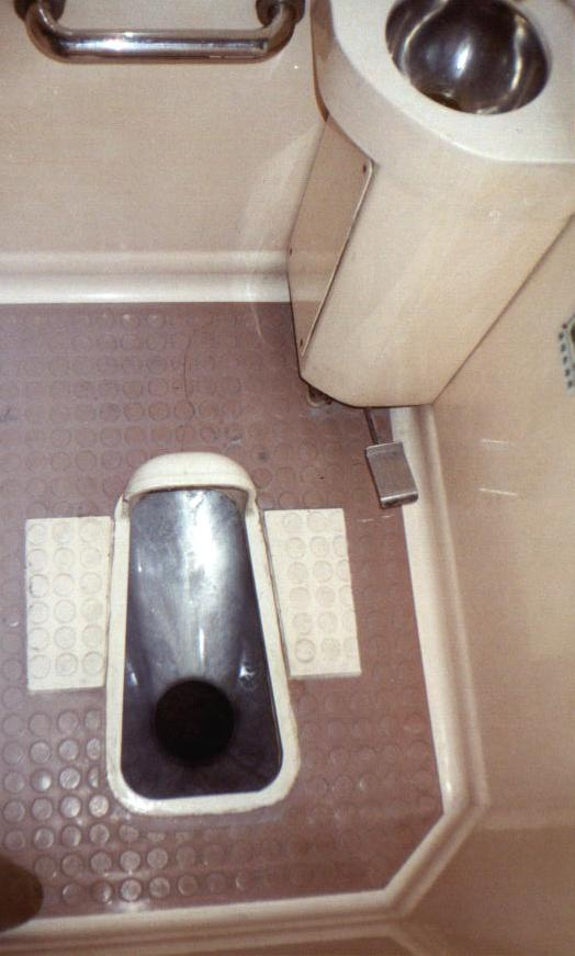 Chinese train squat toilet.