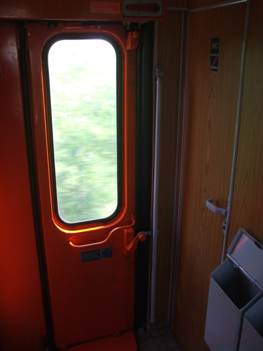 Entry to washroom next to the boarding door of EuroNight passenger train from Romania to Hungary.