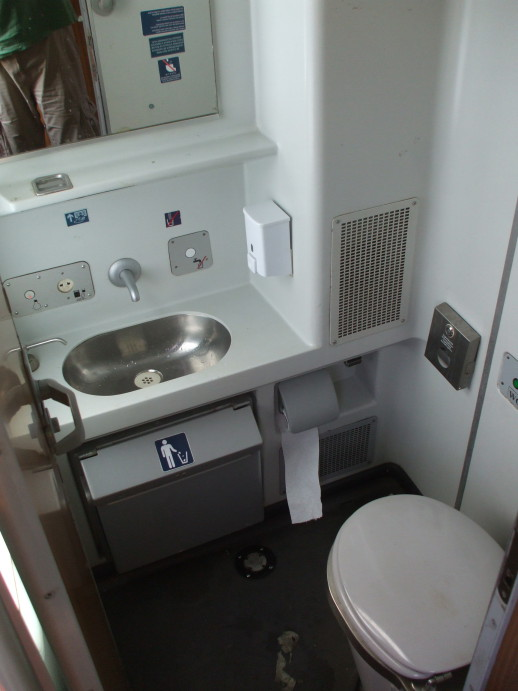 Sink and toilet in the washroom of EuroNight passenger train from Romania to Hungary.