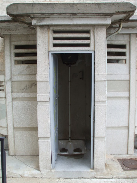 Concrete public squat toilet in Arles, in the south of France.