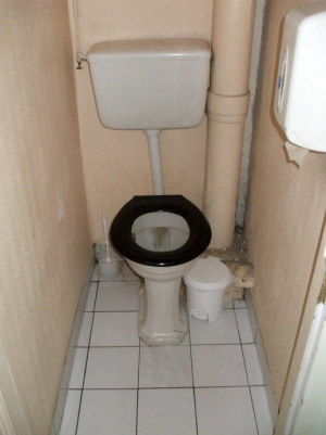 Shared toilet down the hallway in a French hotel.
