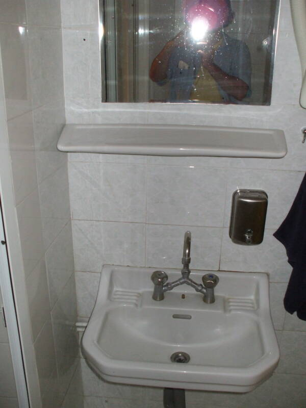 Typical sink and mirror in the Students' and Travelers' Inn, in Athens.