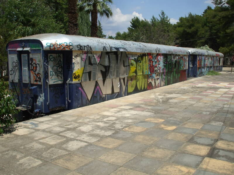 Graffiti-covered train in a park in Nafplio, Greece.