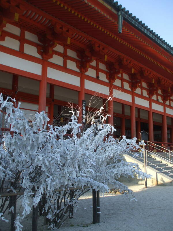Bush with prayer ribbons at the hondo or main hall at Heian-jingū in Kyōto.