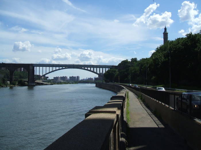The Croton Aqueduct High Bridge connecting Bronx and Manhattan, seen from the walkway along the river on the Manhattan side.