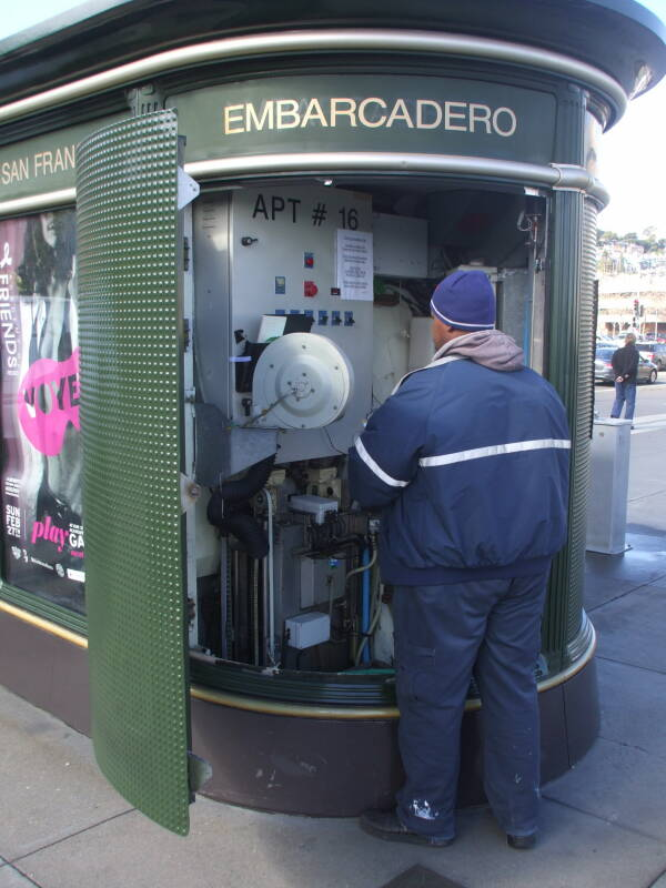 Man working on a French-style automated toilet in San Francisco.