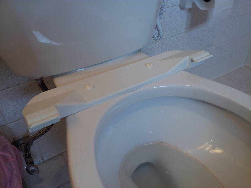 'Booster seat' added to a home toilet.