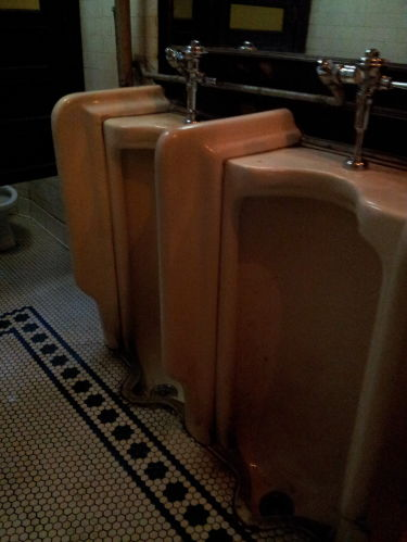 Urinals inside Old Town Bar on 18th Street in the Flatiron District.