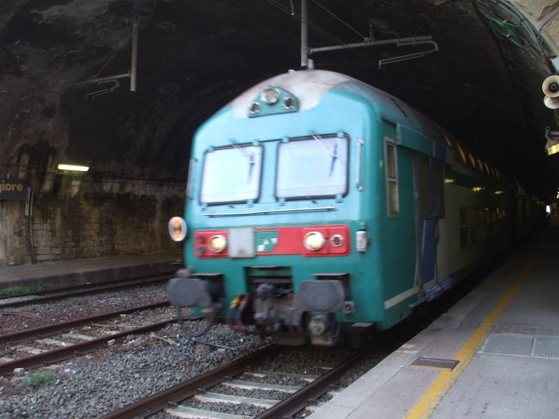 Italian train passing through a tunnel in the Cinque Terre area.