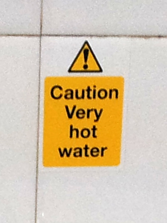 Typical British warning label about unusually hot water.