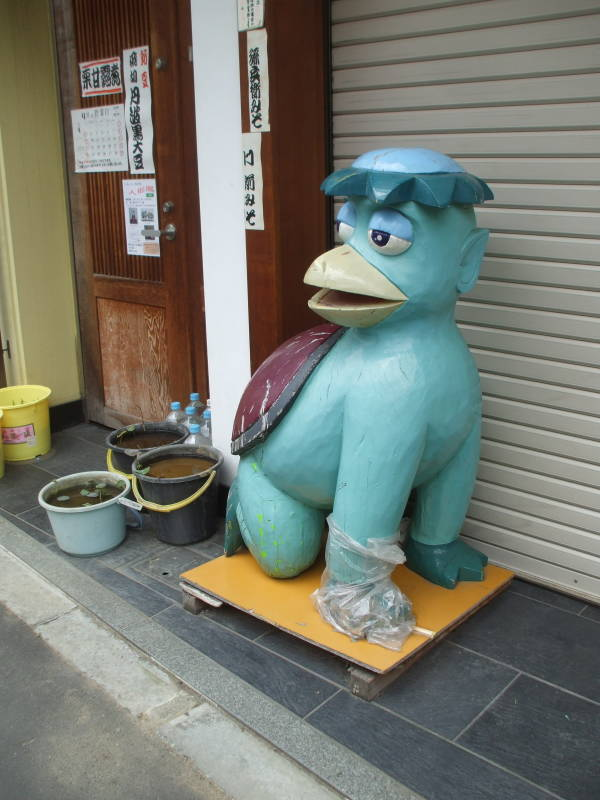 Kappa statue outside a kitchen supply store in Kappabashi-dori or Kitchen Town district of Tokyo.