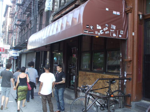 Exterior of Welcome To The Johnson's Bar on Rivington Street on the Lower East Side in New York: brown awning, windows and doors.