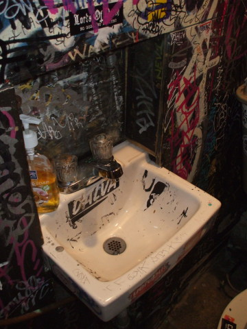 Sink in Welcome To The Johnson's Bar on Rivington Street on the Lower East Side in New York: Dial anti-bacterial soap, hot and cold knobs.