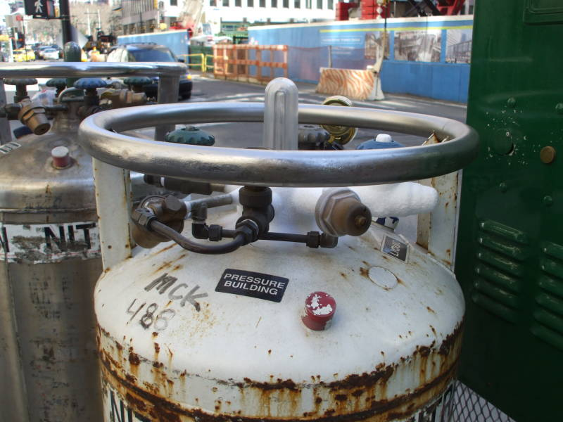 Dewar vacuum flasks of liquid nitrogen on Broadway in New York, on the edge of the Financial District.