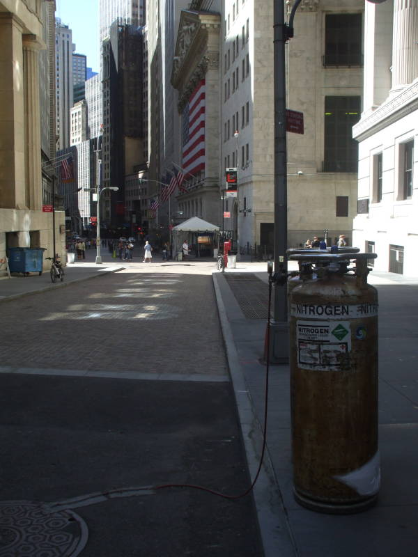 Dewar vacuum flask of liquid nitrogen along the street in front of the New York Stock Exchange, in Manhattan's Financial District.