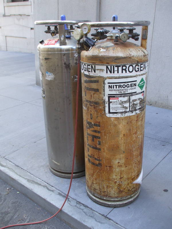 Two dewar vacuum flasks of liquid nitrogen along the street in front of the New York Stock Exchange, in Manhattan's Financial District.