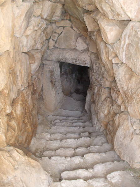 Stone tunnel staircase leading to a large underground water cistern at Mycenae.