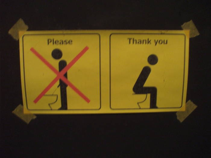 Sit down to pee! Instructional sign in the bathroom at Bar de Nikko, in Nikko.