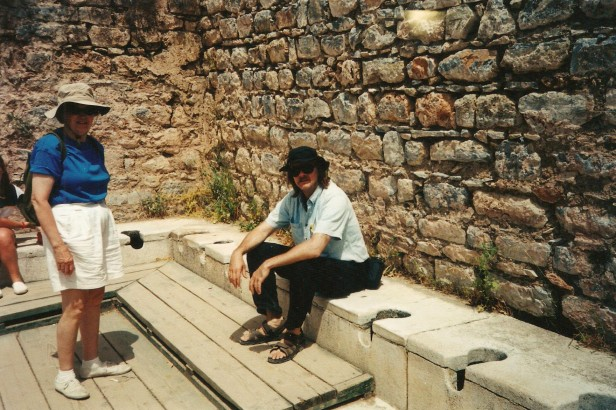 The Toilet Guru sitting on an ancient Greek toilets in Ephesus, in west Turkey.