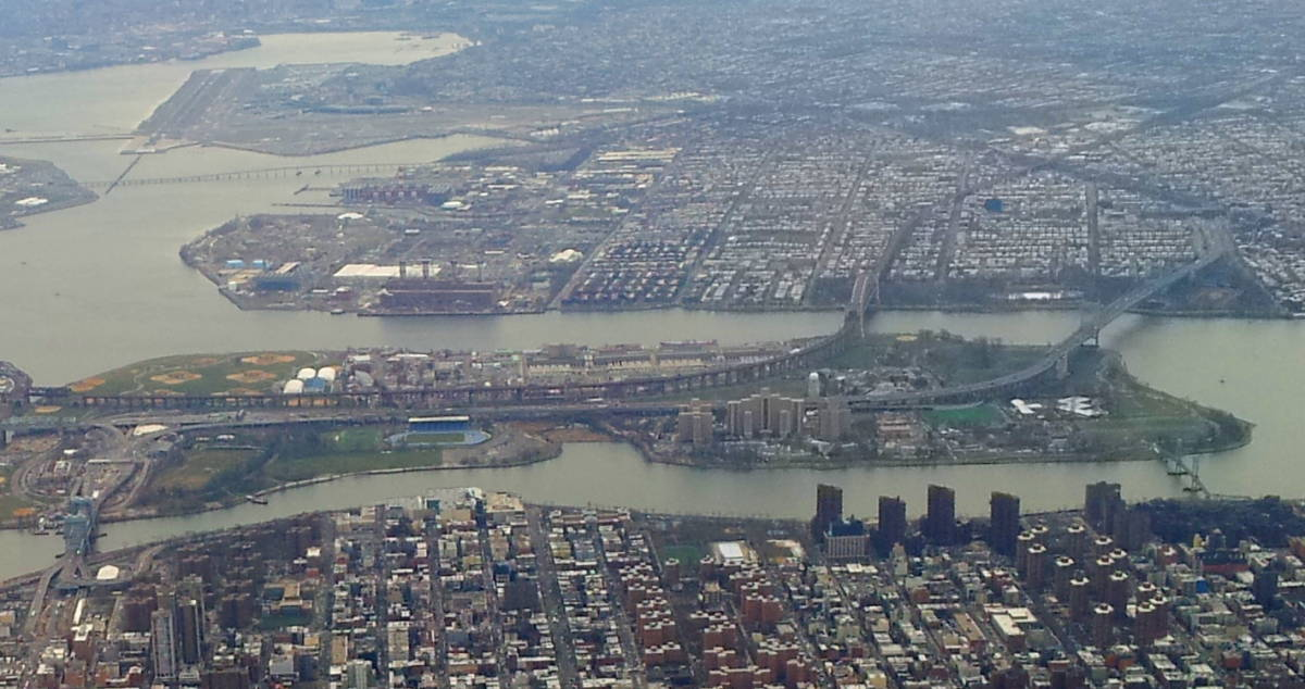 View of Randalls and Wards Island from an airliner traveling north along the Hudson River.