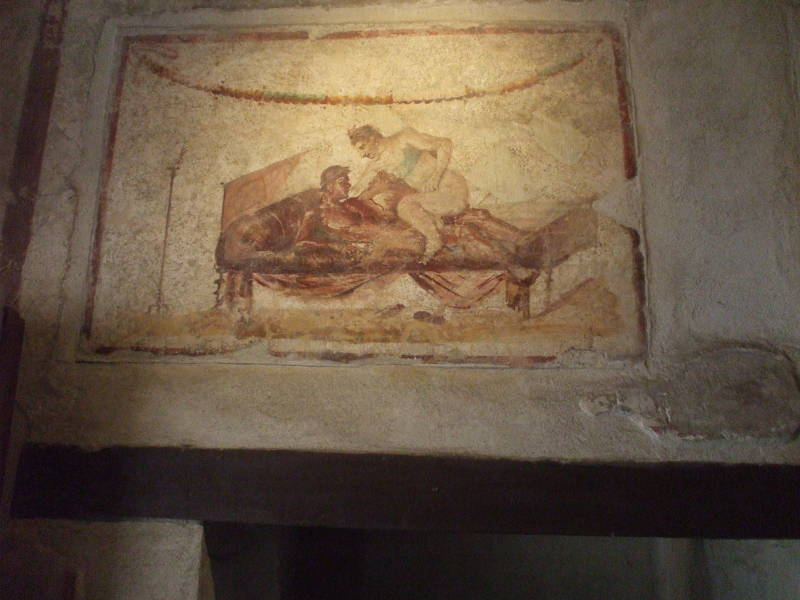 Erotic fresco in the Lupanaro, a Roman brothel at Pompeii.