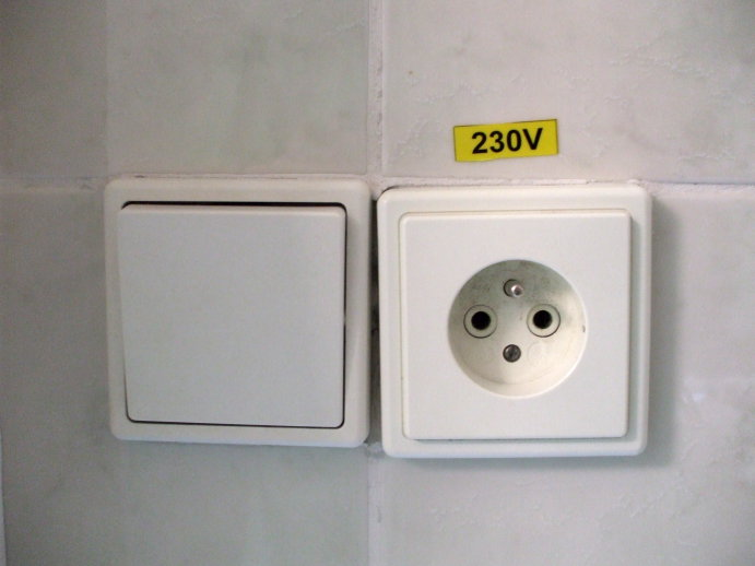 Light switch and grounded outlet in Prague, Czech Republic.