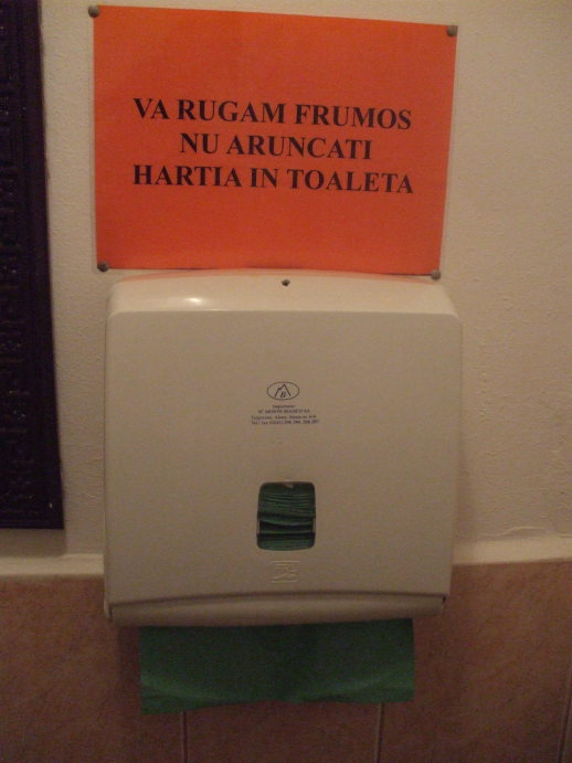 Hand towels and sign in a restaurant in Bistriţa, Romania.