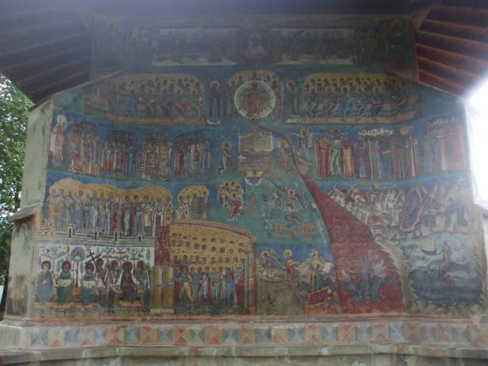 Last Judgement on the porch of one of the Painted Churches of Bucovina, Romania.