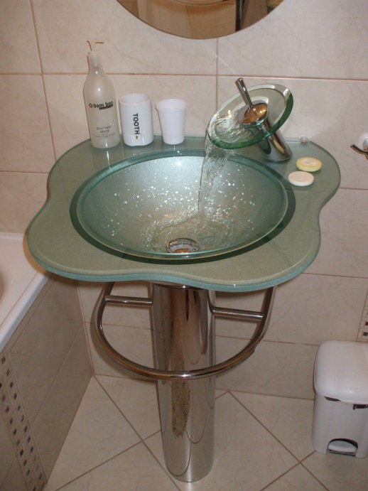 Very nice glass sink with 'bowl' style faucet.