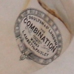 19th century Scottish porcelain toilet labeled 'Doulton of London, the Combination, Works Lambeth and Paisley'.