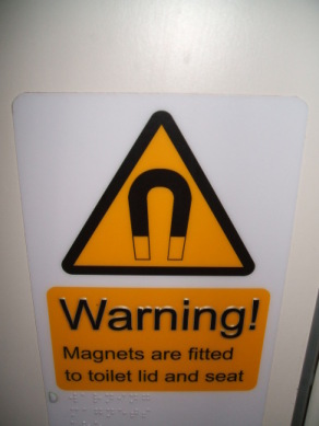 Magnets!  Look out!  MAGNETS!!  And on the toilet!