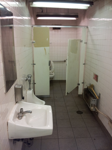 Toilet, urinal and sink in the Delancey Street — Essex Street station of the New York City MTA subway system in Manhattan.