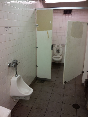 Toilet and urinal in the Delancey Street — Essex Street station of the New York City MTA subway system in Manhattan.