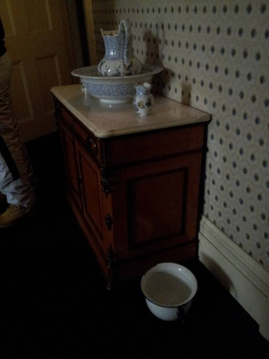 Water basin, pitcher, and chamber pot in Theodore Roosevelt's childhood home at 28 East 20th Street in New York.