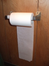 Incorrect orientation of toilet paper roll.
