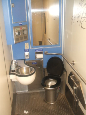 Stainless steel toilet on board a MARC train between Washington and Baltimore.