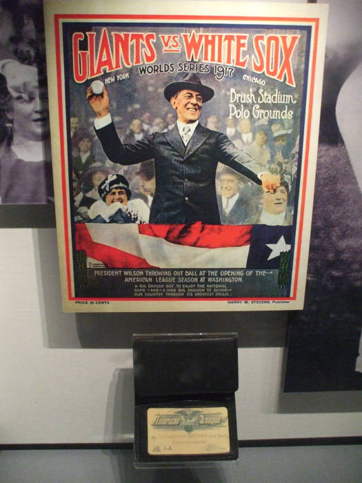 Poster of Woodrow Wilson throwing out the first baseball in the World Series, and Woodrow Wilson's annual pass to the American League.